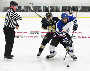 030617  Wesley Bunnell | Staff  Newington-Berlin Hockey at Hall-Southington in a Division III first round game played at Veterans Memorial Skating Rink in West Hartford. Alexander Borselle (17) for Newington-Berlin and Jeremy Fortin (3) for Hall-Southington after a face off.
