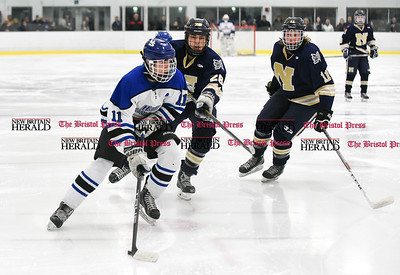 030617  Wesley Bunnell | Staff  Newington-Berlin Hockey at Hall-Southington in a Division III first round game played at Veterans Memorial Skating Rink in West Hartford. H. Dustin Kilgore (11) for Hall-Southington against Logan Matteson (26) and Joseph Fogarty (11).