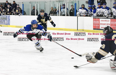 030617  Wesley Bunnell | Staff  Newington-Berlin Hockey at Hall-Southington in a Division III first round game played at Veterans Memorial Skating Rink in West Hartford. Hall-Southington's Jeremy Fortin (3) has his shot stopped by Adam Belair (29).