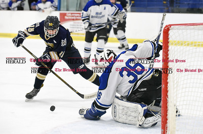 030617  Wesley Bunnell | Staff  Newington-Berlin Hockey at Hall-Southington in a Division III first round game played at Veterans Memorial Skating Rink in West Hartford. Hall-Southington goalie Zachary Monti (36) against Matthew Lavoie (16).