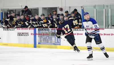 030617  Wesley Bunnell | Staff  Newington-Berlin Hockey at Hall-Southington in a Division III first round game played at Veterans Memorial Skating Rink in West Hartford. Alexander Borselle (17) high fives his teammates after scoring for Newington-Berlin.