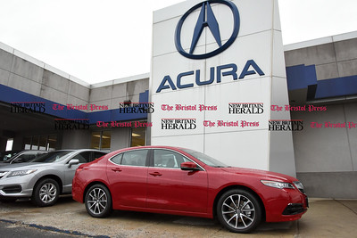 030717  Wesley Bunnell | Staff  Automobiles for sale in front of Acura of Berlin on March 7.