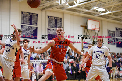 031317  Wesley Bunnell | Staff  St. Paul boys basketball was defeated in a Class S CIAC playoff game against Westbrook on Monday March 13. Tyler Arbuckle (14)