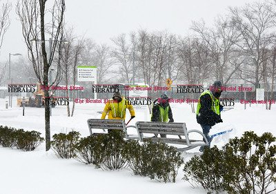 031417  Wesley Bunnell | Staff  Workers clear snow from the CT fastrak station in downtown New Britain on Tuesday March 14.