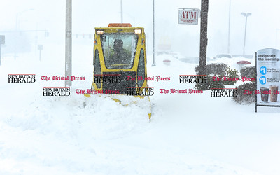 031417  Wesley Bunnell | Staff  A small plow clears the sidewalk near the intersection of of East Main St and Martin Luther King Blvd on Tuesday March 14.