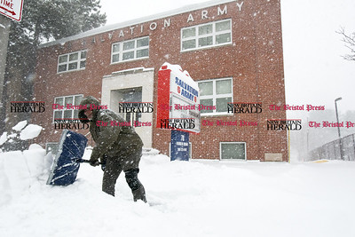 031417  Wesley Bunnell | Staff  Jonathan Markas shovels the sidewalk in front of the New Britain Salvation Army during heavy snow on Tuesday March 14.