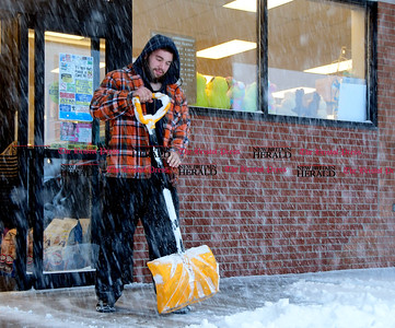 3/14/2017 Mike Orazzi | Staff Rob Desmarais while clearing snow at the Rite Aid Plaza in Plymouth during Tuesday's snow storm.