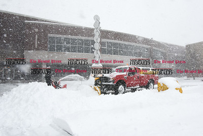 031417  Wesley Bunnell | Staff  Workers clear the front entrance area to New Britain High School during heavy snow on Tuesday March 14.