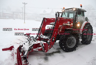 3/14/2017 Mike Orazzi | Staff Rob Desmarais while clearing snow with a 110 horse power Massey Ferguson tractor at the Rite Aid Plaza in Plymouth during Tuesday's snow storm.