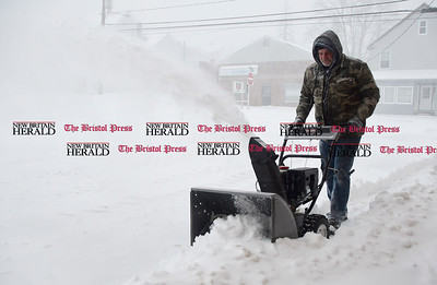 3/14/2017 Mike Orazzi | Staff Lance Simmons clears snow with a snow blower at the Rite Aid Plaza in Plymouth during Tuesday's snow storm.