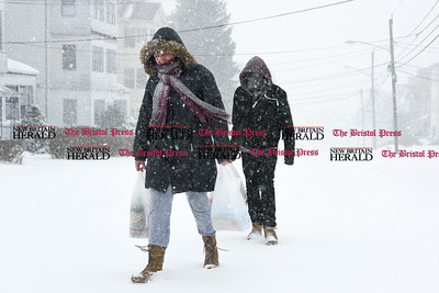 031417  Wesley Bunnell | Staff  Residents walk back home up Smith St. from a convenience store on Broad St during heavy snow on Tuesday March 14.