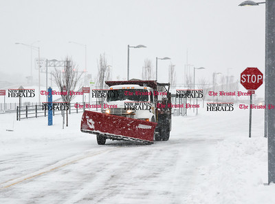 031417  Wesley Bunnell | Staff  A snowplow clears snow from the CT fastrak station in downtown New Britain on Tuesday March 14.