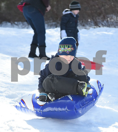 032017 Wesley Bunnell | Staff Taking advantage of the mild first day of spring to sled is Andrew Haggett , age 5, on Mar. 20, 2017.