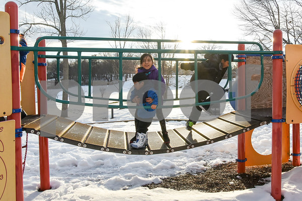 032017 Wesley Bunnell | Staff Jumping up and down on a playscape bridge in Walnut Hill Park Josue Arenas, age 3, Jayline Arenas, age 9, and Adrian Guerrero, age 7, on the first day of spring Mar. 20, 2017.