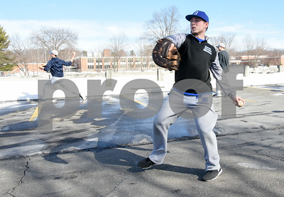 032017  Wesley Bunnell | Staff  Prospective members of the Varisty and Junior Varsity Bristol Eastern Baseball team practice in a parking lot in the front of the school due to snow covered fields on the first day of spring Mar. 20, 2017.