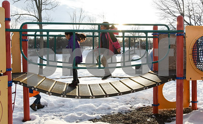 032017  Wesley Bunnell | Staff  Jumping on a playscape walkway in Walnut Hill Park are Jayline Arenas, age 9, and Mairely Guerrero, age 7, on the first day of spring Mar. 20, 2017.