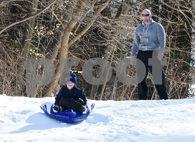032017  Wesley Bunnell | Staff  Taking advantage of the mild first day of spring to sled are Jeff Haggett and his son Andrew Haggett , age 5, on Mar. 20, 2017.