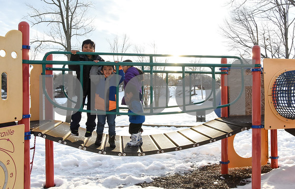 032017 Wesley Bunnell | Staff Jumping up and down on a playscape bridge in Walnut Hill Park are Adrian Guerrero, age 7, Jesus Balbuena, age 6, Jayline Arenas, age 9, and Josue Arenas age 3 on the first day of spring Mar. 20, 2017.