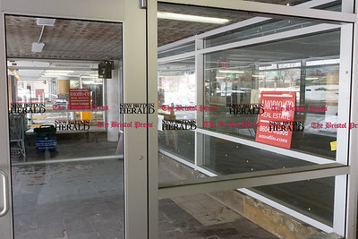 032117  Wesley Bunnell | Staff  31 Bank St New Britain storefront of the Szczesny Parking Garage. Ticket Defenders which will be a satellite office of the Howard Law Firm will occupy the space.