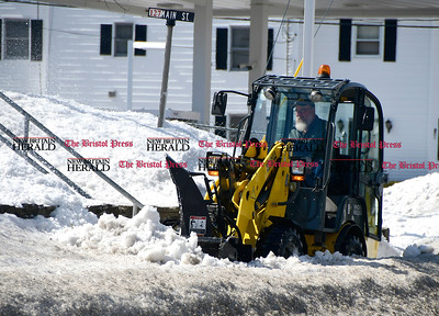 3/21/2017 Mike Orazzi | Staff Snow removal from sidewalks along Route 6 in Terryville as Plymouth cleans up from last week's snow storm on Tuesday.