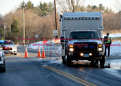 3/21/2017 Mike Orazzi | Staff A closed Route 72 at the intersection of Blueberry Hill Road in Harwinton after the body of an infant was discovered in Bristol's Reservoir Number 4 Tuesday.