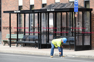 032117  Wesley Bunnell | Staff  The New Britain Fire Department investigated a possible gas leak at 267 Main St on March 21, 2017. A CNG employee marks portions on the Bank St side of the building.