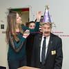 032317  Wesley Bunnell   Staff<br /> <br /> Peter Spano, a WWII Navy Veteran, celebrated his 90th at Tunis Community College where is taking classes on March 22, 2017 with fellow veteran students and faculty. Amber Humphrey adjusts Peter's 90th birthday hat.