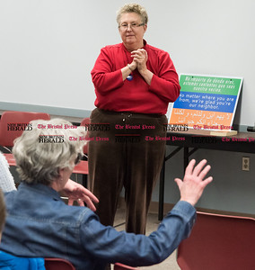 032217  Wesley Bunnell | Staff  A presentation took place at the Berlin-Peck Library on March 22, 2017 exploring the refugee experience while attempting to gain residency in the U.S. and difficulties they face once here.  Presenter Hope Lennartz listens to a question from an audience member.