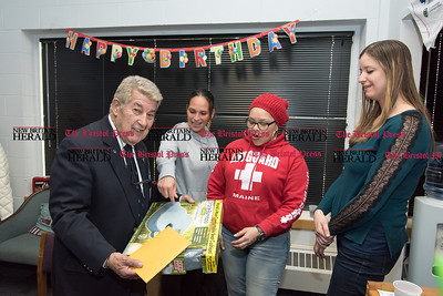 032317  Wesley Bunnell | Staff  Peter Spano, a WWII Navy Veteran, celebrated his 90th at Tunis Community College where is taking classes on March 22, 2017 with fellow veteran students and faculty. Receiving his present is Peter Spano with Jamaly Rios, Deedee Rodriguez and Amber Humphrey.