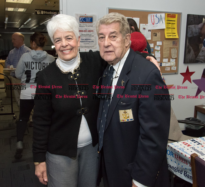 032317  Wesley Bunnell   Staff<br /> <br /> Peter Spano, a WWII Navy Veteran, celebrated his 90th at Tunis Community College where is taking classes on March 22, 2017 with fellow veteran students and faculty. School president Dr. Cathryn Addy poses with Peter Spano.