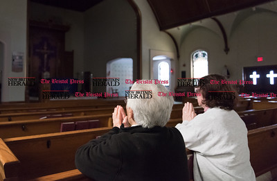 032417  Wesley Bunnell | Staff  Teresa Pistritto,left, prays with Mary Scalise at St. Paul's Church in Kensington on March 24, 2017. St. Paul's and Sacred Heart in East Berlin have merged leading to the eventual closing of Sacred Heart.