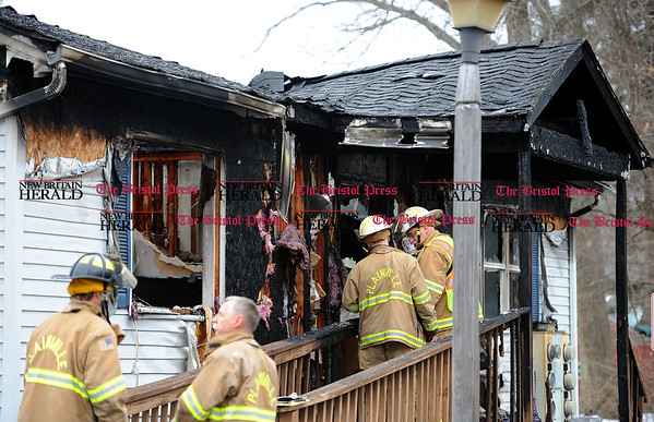 3/24/2017 Mike Orazzi   Staff Plainville firefighters on scene of house fire on Milford Street Extension Friday morning.