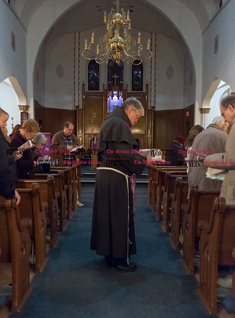 031017 Wesley Bunnell   Staff Fr. Robert Schlageter leads parishioners at Sacred Heart Church in East Berlin in Stations of the Cross on March 10, 2017. St. Paul's and Sacred Heart in East Berlin have merged leading to the eventual closing of Sacred Heart.