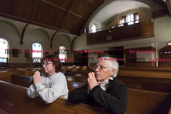 032417 Wesley Bunnell   Staff Mary Scalise , left, prays with Teresa Pistritto at St. Paul's Church in Kensington on March 24, 2017. St. Paul's and Sacred Heart in East Berlin have merged leading to the eventual closing of Sacred Heart.