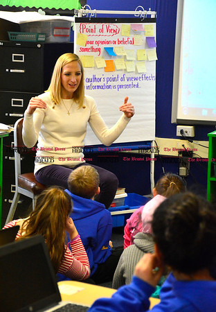 2/17/2016 Mike Orazzi   Staff South Side School teacher Julia Darcy demonstrates how to use presentation software PowToon to her classmates as part of the school's digital learning program.