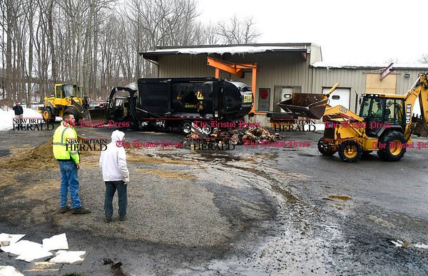3/24/2017 Mike Orazzi   Staff A burned up CWPM waste removal truck that caught fire and was destroyed off Napco Drive in Plymouth Friday morning. Terryville firefighters unloaded the truck with a backhoe and cut a hole in the side in order to extinguish the blaze.