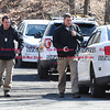 033017  Wesley Bunnell | Staff<br /> <br /> Plainville detectives arrive to aid in the search for missing hiker Arthur Williams in the woods off of Loon Lake Road. Williams was last seen on Saturday.