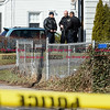 032917  Wesley Bunnell | Staff<br /> <br /> New Britain Police Officers stand outside of a home on Newington Ave on Wednesday following the shootings of three people earlier that morning.