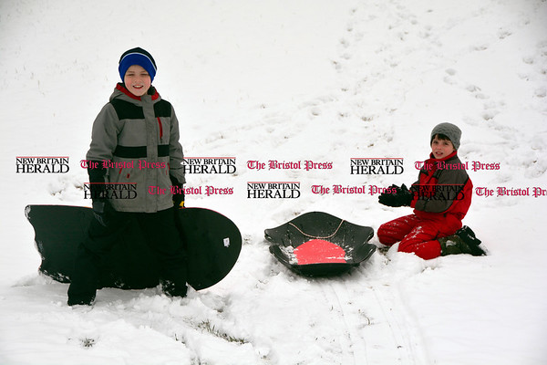 3/10/2017 Mike Orazzi   Staff Luke and Matthew Lamontagne while sledding on some fresh snow at Nelson's Field in Bristol Friday afternoon.