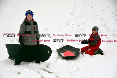 3/10/2017 Mike Orazzi | Staff Luke and Matthew Lamontagne while sledding on some fresh snow at Nelson's Field in Bristol Friday afternoon.