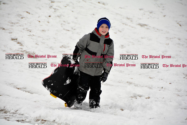 3/10/2017 Mike Orazzi   Staff Luke Lamontagne while sledding on some fresh snow at Nelson's Field in Bristol Friday afternoon.