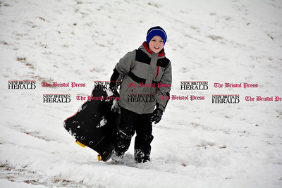 3/10/2017 Mike Orazzi | Staff Luke Lamontagne while sledding on some fresh snow at Nelson's Field in Bristol Friday afternoon.