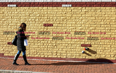 030917  Wesley Bunnell | Staff  Angelis Almenas walks down Walnut St New Britain in the late day sun on Friday March 10.