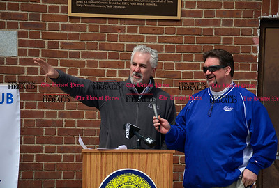 4/1/2015 Mike Orazzi | Staff Bristol Superintendent of Parks and Recreation. Ed Swicklas (left) talks about renovations at Muzzy Field on Wednesday afternoon during a press conference about the Bristol Blues. On the right is Rich Muntean, the team's general manager.