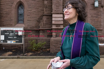 030117  Wesley Bunnell | Staff  Pastor Jane Rowe stood outside South Church on Ash Wednesday as part of Ashes to Go. The service is about bringing the service out from behind church doors and into places of everyday life. Pastor Rowe holds the container of ashes covered with paper outside.