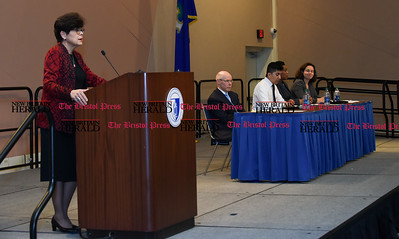 030117  Wesley Bunnell | Staff  CCSU held an informative panel titled Uncertainty around Immigration Law on March 1. CCSU President Dr. Zulma Toro, left, gives opening remarks as the panel is seated from the left is immigration attorney Jeffrey Dressler, CCSU Student Mariano Cardoso, CCSU CIE Assistant Director Toyin Ayeni and immigration attorney Monika Gradzki.