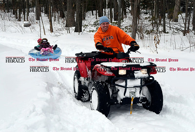 3/15/2017 Mike Orazzi | Staff Bryan Theriault gives a ride around the yard to his daughter Ava,5, and friend Ellie Hudson off Shagbark Drive in Bristol while enjoying the latest snowfall Wednesday.