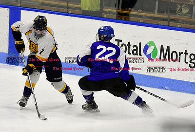 3/18/2017 Mike Orazzi | Staff Woodstock Academy's Ryan Black (7) and  Hall-Southington's Colby Glidden (22) during the CIAC 2017 State Boys Ice Hockey Tournament Division III Finals at Ingalls Rink in New Haven Saturday.