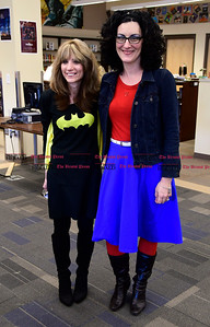 "3/2/2017 Mike Orazzi | Staff West Bristol School's Judy Michaud and Tina Monteleone as Batgirl and Wonder Woman during ""Read Across America Day"" in Bristol Thursday."