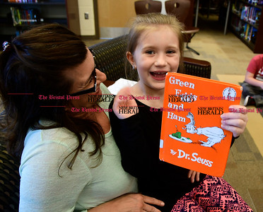 "3/2/2017 Mike Orazzi | Staff West Bristol School's Haley Pilon reads to 4th and 5th grade students during ""Read Across America Day"" in Bristol Thursday. Sitting with her is her mom and hero Jen."